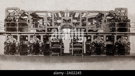 The latest engineering and technology from the 1930s: a modern, giant newspaper press powered by 2 85 HP motors. It can produce 100,000 24 page newspapers per hour and also has automatic folders and late news devices. - Stock Photo