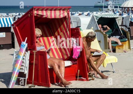 Seniors, German people vacation on a beach of Baltic Sea Germany Warnemunde - Stock Photo