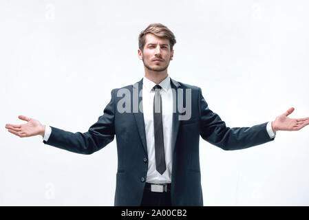 the man stands and spreads his hands - Stock Photo