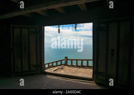 Beautiful sea view through open old doors. Sunny summer day seascape. Shizuoka, Japan - Stock Photo