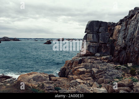 Scenic view of rock formation against sky in pink granite coast, Gouffre, Brittany, France - Stock Photo