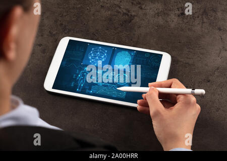 Business woman making analyses and checking fingerprints on tablet - Stock Photo