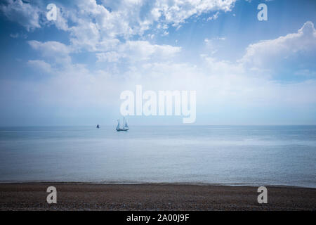 Yachts at sea in the English Channel off the coast of Dungeness in Kent, UK - Stock Photo