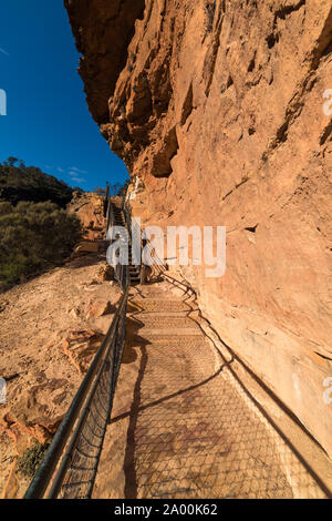 Mountain track staircase over steep cliff edge. Wentworth Falls, National Pass Track, Blue Mountains National Park, New South Wales, Australia - Stock Photo