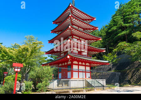 Chureito Pagoda against blue sky and green trees on the background. Fujiyoshida, Yamanashi prefecture, Japan - Stock Photo