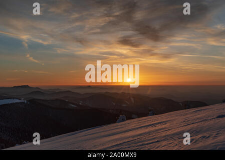 sunset from Veterne hill on Martinske hole in Mala Fatra mountains in Slovakia during winter with colorful sky - Stock Photo