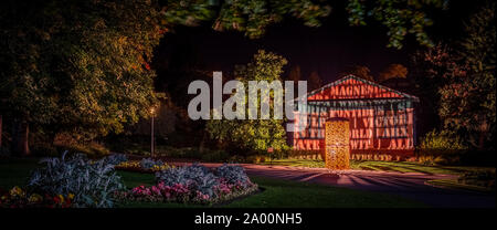 Valley Gardens, Harrogate, United Kingdom. 18th September, 2019. Eddie Roberts' sculpture is lit up overnight in the Valley Gardens, celebrating the heritage of the town and welcomes the world as the UCI World Championships take place between 21 to 29 September 2019 in and around Harrogate North Yorkshire, UK. Credit: Caught Light Photography/Alamy Live News.