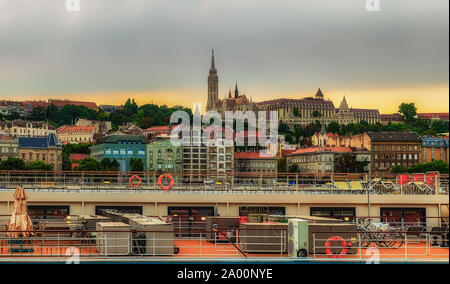 Budapest, Hungary, Aug 2019, view of the top deck of a Viking River Cruises boat on the Danube opposite the Fisherman's Bastion and the Matthias Churc - Stock Photo