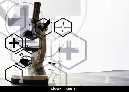 Research laboratory. Test tubes and microscope on the table. Double exposure. - Stock Photo