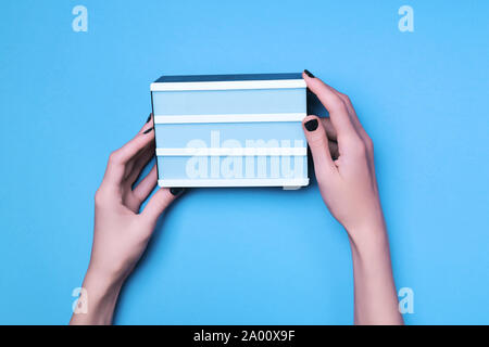 White board in woman hands. Place for words written on board - Stock Photo