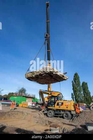 Berlin, Germany. 19th Sep, 2019. A crane has part of the tank barrier in the Mauerpark back in place. It had been transferred for the work of the water companies on the reservoir canal, which is to store waste water. Credit: Andreas Gora/dpa/Alamy Live News - Stock Photo