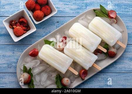 Icy popsicles over ice - Stock Photo