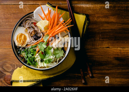 Vegetarian miso ramen with shiitake mushrooms, fried tofu, carrot, cabbage, leek and lime. Asian cuisine - Stock Photo