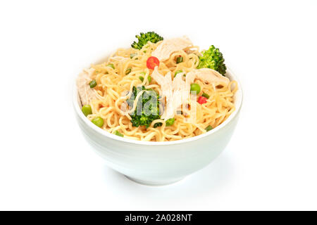 A bowl of soba noodles with vegetables and chicken meat on a white background - Stock Photo