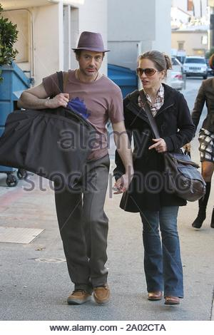 Beverly Hills, CA - Robert Downey Jr. and wife Susan Levin share a lovable conversation while holding hands during a mini high end shopping spree this afternoon. The 'Sherlock Holmes' star looked to get some nice threads at Bottega Veneta and a hefty purchase at the Gucci store. GSI Media February 10, 2010 - Stock Photo