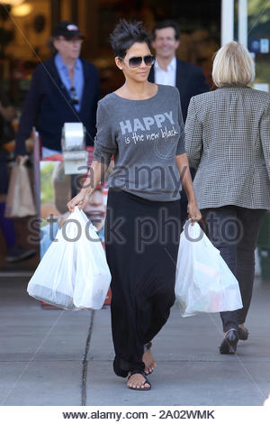 West Hollywood, CA - The 'Cloud Atlas' star, Halle Berry is in a good mood as she leaves Bristol Farms today in West Hollywood. It looks like she is living by the message of her sweater, 'Happy Is The New Black'. AKM-GSI October 24, 2012 - Stock Photo