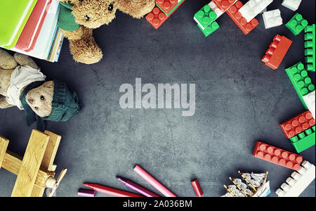 Background. Children's toys on the table. Space between kid's toys. - Stock Photo