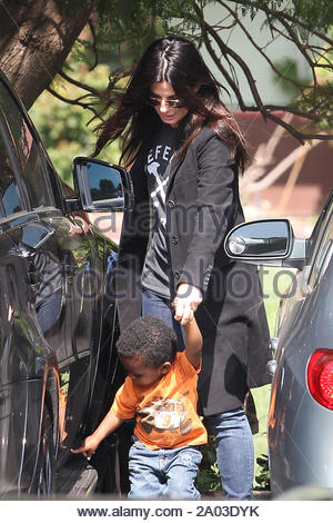Beverly Hills, CA - Actress Sandra Bullock picks up her son Louis from school today and has a laugh as Louis appeared to be a little curious of a parked car. AKM-GSI March 15, 2012 - Stock Photo