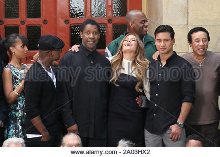 Los Angeles, CA - Jennifer Lopez shares a few laughs with fellow Boys & Girls club ambassador Denzel Washington and good friend Mario Lopez as they join a long list of stars for a photo shoot. Among those out to support the Boys & Girls club today were R&B artist Ne-Yo and Ashanti, basketball legends Magic Johnson and Shaquille O'Neal, Cuba Gooding Jr., Martin Sheen, Kerry Washington, Smokey Robinson, boxing legend Sugar Ray Leonard, Edward James Olmos, and hair dresser Paul Mitchell. GSI Media June 21, 2011 - Stock Photo