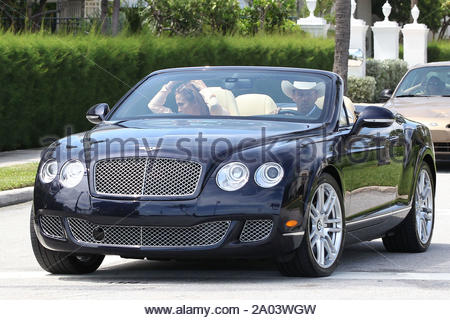 Palm Beach, FL - Jennifer Lopez gets back to work on her latest film 'Parker' and sits in the passenger seat of a drop top Bentley while co-star Jason Statham drives down Ocean Blvd in Palm Beach, Florida wearing a cowboy hat. GSI Media September 19, 2011 - Stock Photo