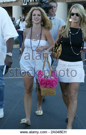Scottsdale, AZ - After a day of shopping and fun with her favorite cousin Laura Lynn, Britney Spears stops off at J Verve Salon & Day Spa for a makeover. She was spotted hanging out in the hot Arizona sun in the back of the building with her cousing, dog, and bodyguard. Britney really seems happy and enjoying her family vacation in Scottsdale, Arizona. GSI Media April 29, 2005 - Stock Photo