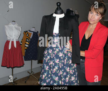 19 September 2019, Saxony, Bautzen: The exhibition designer Anne Hasselbach stands next to exhibits in the exhibition 'Sorbian Street Style' in the Sorbian Museum. The traditional costumes disappear more and more from the everyday life of Lusatia. The Sorbian Museum Bautzen is now showing how traditional patterns, colours, cuts and shapes can be turned into wearable everyday fashion. (to 'Exhibition 'Sorbian Street Style': Creative inspirations from the chest') Photo: Miriam Schönbach/dpa-Zentralbild/ZB - Stock Photo