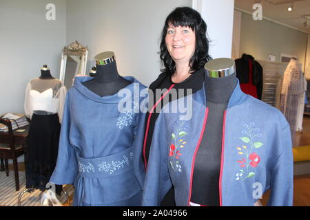 19 September 2019, Saxony, Bautzen: Designer Corinna Seiler from Bautzen presents two outfits of her collection in the exhibition 'Sorbian Street Style' in the Sorbian Museum. The traditional costumes disappear more and more from the everyday life of Lusatia. The Sorbian Museum Bautzen is now showing how traditional patterns, colours, cuts and shapes can be turned into wearable everyday fashion. (to 'Exhibition 'Sorbian Street Style': Creative inspirations from the chest') Photo: Miriam Schönbach/dpa-Zentralbild/ZB - Stock Photo