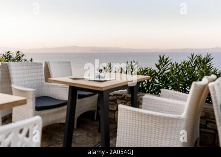 blur background of wicker chairs and tables in a summer cafe with sea views. Restaurant sea terrace - Stock Photo