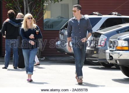 Santa Monica, CA - Reese Witherspoon and Jim Toth leave church in Santa Monica, CA on Sunday morning. Reese sends text messages from her cell phone as they walk back to their car. AKM-GSI April 15, 2012 - Stock Photo