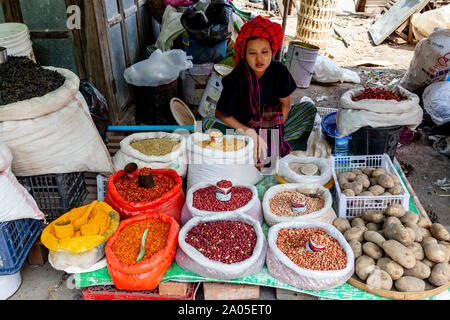 A Young Woman From The Pa'O Ethnic Group Selling Spices In The Mingalar Market, Nyaung Shwe, Lake Inle, Shan State, Myanmar. - Stock Photo