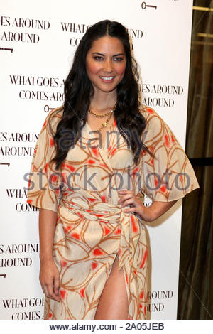 Los Angeles, CA - 'Attack of The Show' host Olivia Munn shows some leg as she attends the 'What Goes Around Comes Around' party at Space15Twenty during LA Fashion Week. Olivia came with vintage in mind, wearing an old fashion print dress with a high cut leg line, paying homage to the vintage lifestyle brand and it's one year anniversary. GSI Media March 18, 2010 - Stock Photo