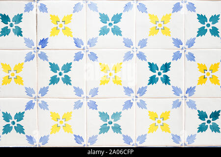 Traditional ornate portuguese decorative tiles azulejos in white, yellow, green and blue colours. - Stock Photo