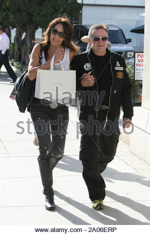 Beverly Hills, CA - Comedian Robin Williams seen making his way around town today with a new girl. The couple looked to be enjoying the sunny afternoon, holding hands walking down the street and sharing a few good laughs. Good to see Robin happy and healthy after going through open heart surgery early in 2009. GSI Media November 9, 2009 - Stock Photo