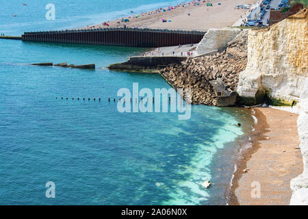 View of Seaford town, East Sussex, England from cliff tops, beautiful blue sea, beach, groins, selective focus - Stock Photo