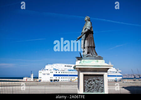 Marseille, France - May 6, 2011: Statue and luxury boat next to Marseille Cathedral. It is a Roman Catholic cathedral, and a national monument of Fran - Stock Photo