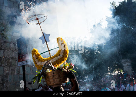 July 28, 2019: Performers with some fireworks during the parade in the Guelaguetza festival in Oaxaca, Mexico - Stock Photo