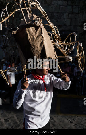 July 28, 2019: A performer wearing some fireworks over his head during the parade in the Guelaguetza festival in Oaxaca, Mexico - Stock Photo