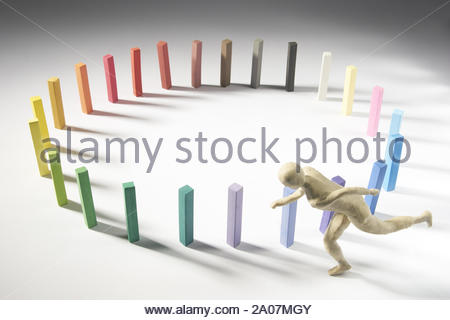 Man runs around a color circle. Isolated on gray background. With copy space text. Studio Shoot. - Stock Photo