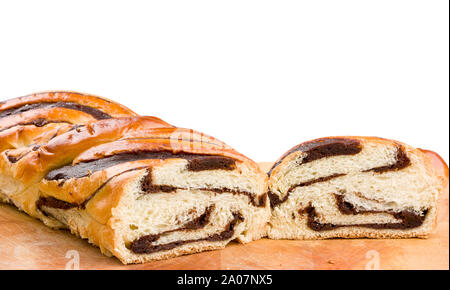 Sweet marbled brioche plait with chocolate Yeast cake Dough babka white background - Stock Photo