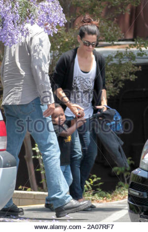 Beverly Hills, CA - Sandra Bullock picks up her boy, Louis Bardo from school today and hands his mom his things for her to hold. AKM-GSI June 14, 2012 - Stock Photo