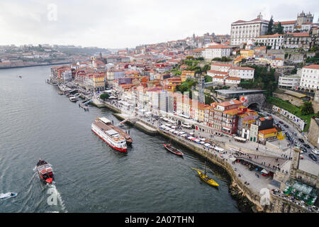 Porto, Portugal - December 2018: View of the Ribeira area and the Douro River with several tourist boats. - Stock Photo