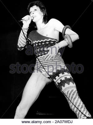 July 4, 1973 - London, England, United Kingdom - Pop star DAVID BOWIE, born January 8, 1947, performing live on stage at his final concert at the Odeon Theatre. He proclaimed to fans at the end, that 'this is the concert I will never forget, as it's the last I'll ever do.'  (Credit Image: © KEYSTONE Pictures USA/ZUMAPRESS.com) - Stock Photo
