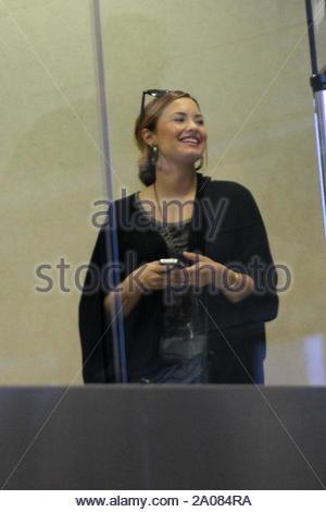 Los Angeles CA - Demi Lovato smiles at LAX AKM-GSI March 12, 2012 - Stock Photo