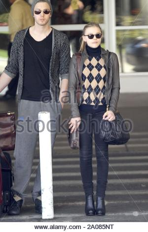 Los Angeles, CA - Actress Chloe Moretz arrived at LAX today smiling. Chloe expressed her excitement recently about landing her role in the remake of Stephen King's novel, 'Carrie'. AKM-GSI March 27, 2012 - Stock Photo