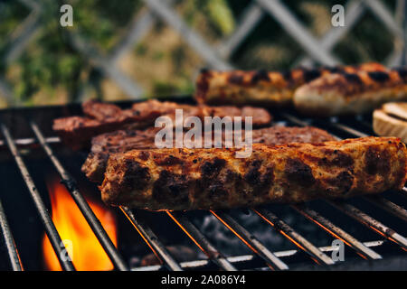 barbecue on summer evening - Stock Photo