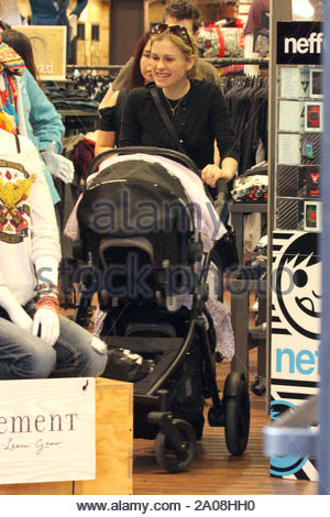 Santa Monica, CA - 'True Blood' stars Anna Paquin and Stephen Moyer take their three-month old twins Christmas shopping in Santa Monica on Dec. 17th, where they walked around and stopped by the Apple store among a few others. This is Anna and Stephen's first kids together (Stephen has children from previous relationships) and will be spending their first Christmas as parents this year. AKM-GSI December 19, 2012 - Stock Photo