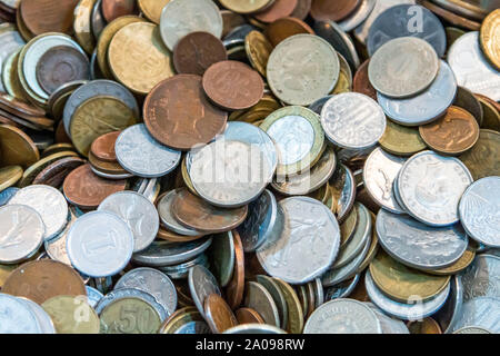 Old antique coins on display in antique shop - Stock Photo