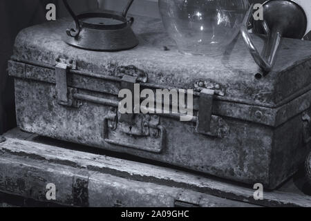 Antique old vintage metal suitcase in black and white picture - Stock Photo