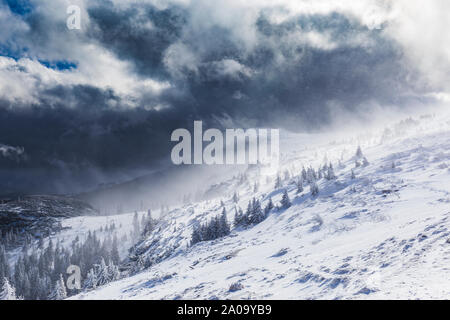 Mountain peak engulfed by storm blizzard, Romania - Stock Photo