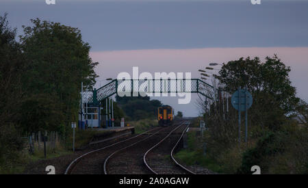 Arriva Northern rail class 156 sprinter train departing from  Kirkby In Furness railway station on the Cumbrian coast railway line - Stock Photo
